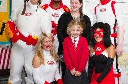Maddison with her school teacher and the comic heroesMaddison with her school teacher and the comic heroes