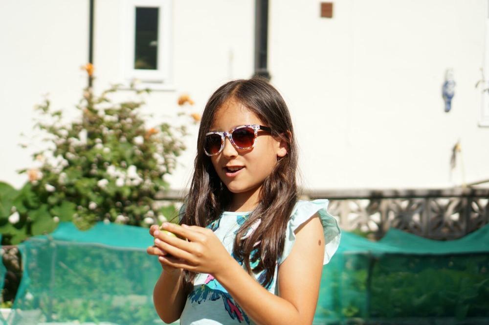 Sophia wearing Monkey Monkey Sunglasses Floral Print